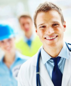 Portrait of a young confident doctor smiling and contracters standing behind